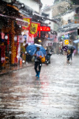 Umbrella seller in west street Yangshuo China