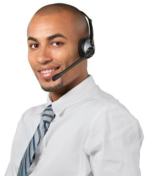 Portrait of a smiling man with headset working as a call center