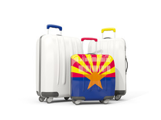 Luggage with flag of arizona. Three bags with united states local flags