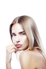 Beauty young woman portrait isolated on white background. Beautiful model girl with nude makeup, natural lips, perfect fresh skin, blue eyes. Youth and Skincare Facial Treatment Concept