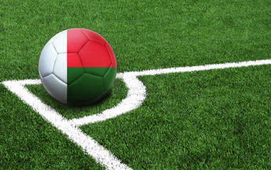 soccer ball on a green field, flag of Madagascar