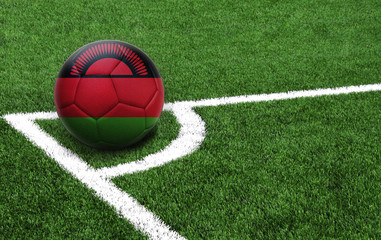 soccer ball on a green field, flag of Malawi
