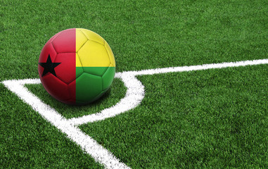 soccer ball on a green field, flag of Guinea-Bissau
