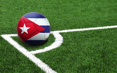 soccer ball on a green field, flag of Cuba