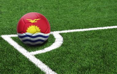 soccer ball on a green field, flag of Kiribati