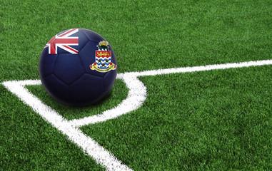 soccer ball on a green field, flag of Cayman islands