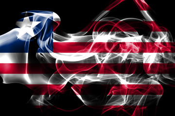 National flag of Liberia made from colored smoke isolated on black background