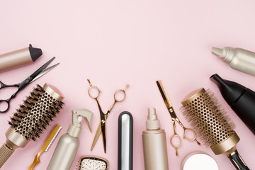 Various hair dresser tools on pink background with copy space Wall mural