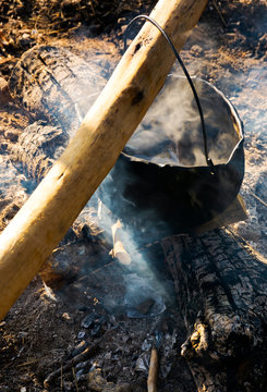 cooking in cauldron on open fire. view from above. healthy food made in natural way