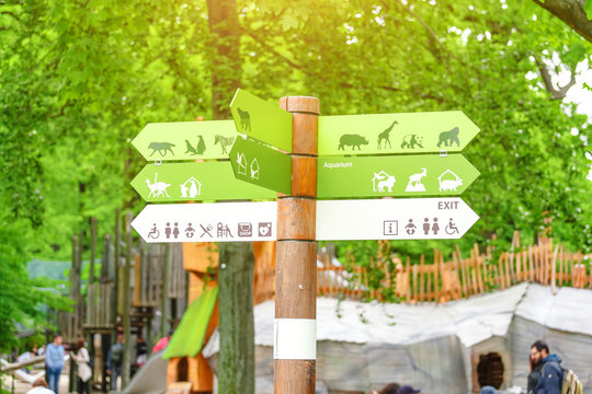 Informational visitor sign pointer to tourist destinations in Berlin Zoo