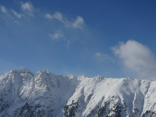 Winter snow covered mountain peaks in Europe. Great place for  sports