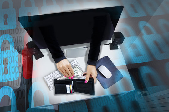 Cyber attack or online fraud with hacker's hands stealing money and credit cards from men's wallet