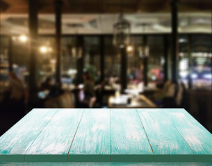 Wood table with blured background cafe , for your photo montage or product display. Space for placing items on the table.