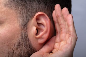Fototapeta Close-up Of A Man Trying To Hear obraz