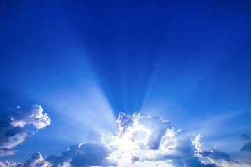 sun rays with clouds on blue sky landscape.rays of light.