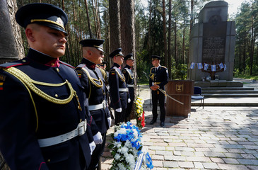 Soldiers prepare prior to commemoration of victims and award ceremony of the Righteous Among the Nations at the Paneriai Memorial in Vilnius