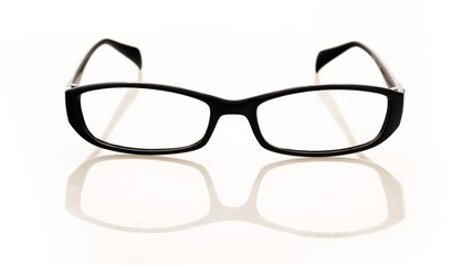 Eyeglasses And Its Reflection Against Light Background