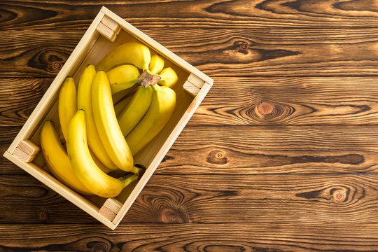 Large rectangular wooden box holding bananas