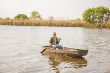 man fishing on a lake- Fisherman in fishing boat .