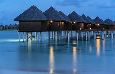 Luxury water villa sunset in Maldives