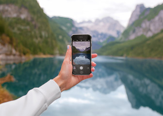 Smartphone in hand, photographing nature