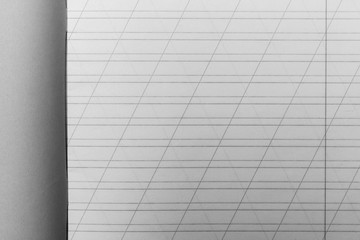 open school notebook in a narrow line with a slash for learning spelling, mock up with copy space, black and white photo