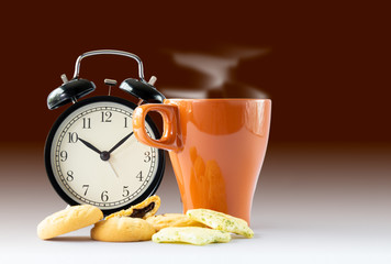 Hot coffee and alarm clock with biscuits on the table : Concept for coffee time