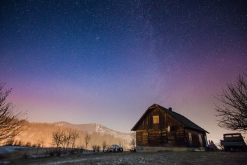 Abandoned house at night in the mountains