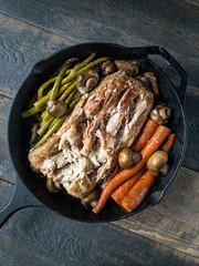 Cast iron with pork roast carrots and asparagus
