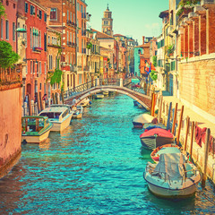 Canal with moored motorboats in Venice