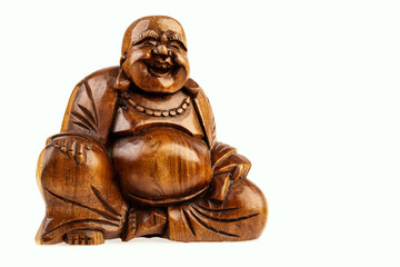 isolated wooden statuette of a happy buddha on a white background
