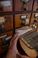 A manbrowses through cards from a drawer of the Universal Bibliographic Repertory in Mons