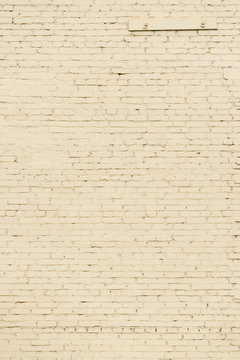 Old yellow brick wall texture. Vintage stonewall wallpaper. Peeled Rough Decayed Brick Wall Textured Background. Abstract Web Banner