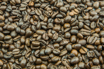 Coffee beans for background. Selective focus and shallow depth of field.