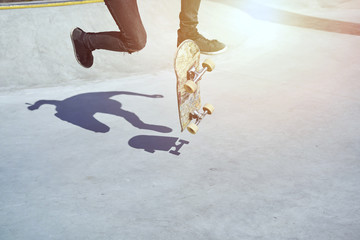 Skateboarder doing a trick in a skate park, practice freestyle extreme sport .