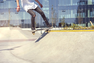 Skateboarder doing a trick in a skate park, practice freestyle extreme sport