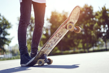 Skateboarder in a skate park, practice freestyle extreme sport