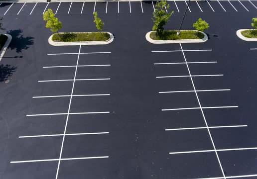 parking lot,asphalt,island,trees,stalls,parking stalls,paint,green