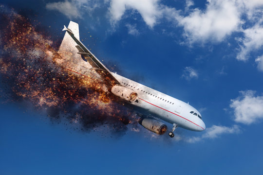 exploding and  burning aircraft in the sky before crashing down