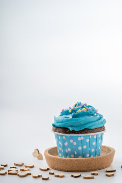 Tasty colorful cupcake isolated on white background, close up.
