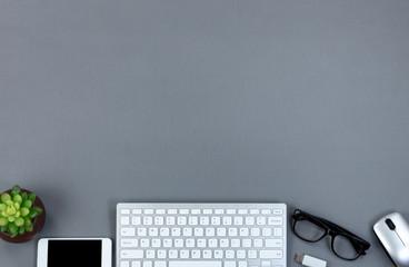 Gray desktop with bottom border at work technology