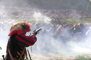Lansquenet mercenary soldier aiming a flintlock gun