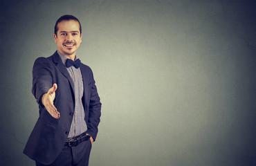 Cheerful business man giving handshake