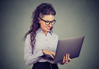 happy business woman standing using laptop computer