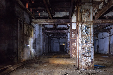 Dark and creepy interior of abandoned factory