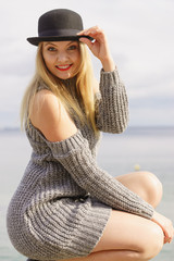 Woman wearing fedora and jumper outdoor