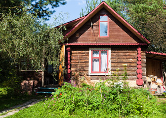 front view of rural log house on sunny summer day