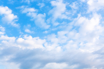 many white clouds in blue evening sky in summer