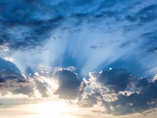 dark blue rainy clouds over sunset in summer