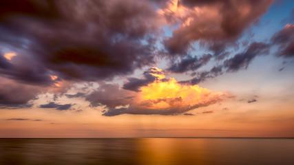 Golden Orange sunset clouds over Lake Superior Horizon